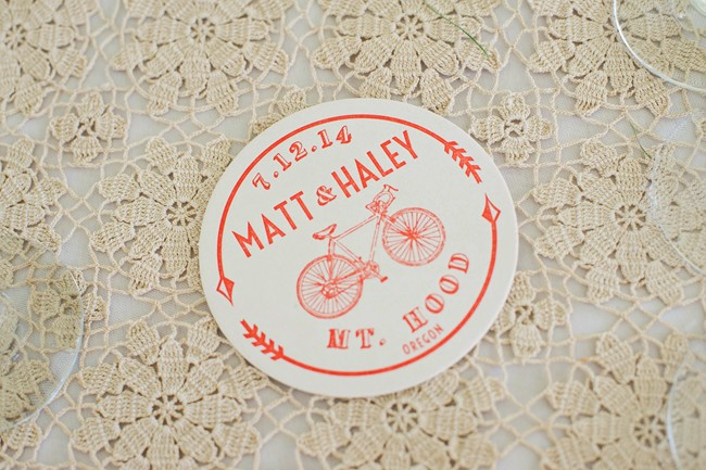 Orange wedding reception coaster with the bride and grooms name and mt hood