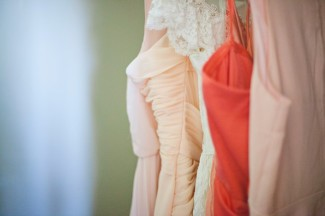 Peach, pink, and rose bridesmaids dresses in a row