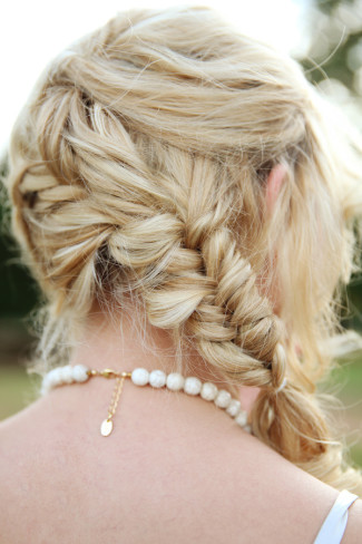 blond bride wearing braid and pearl necklace