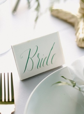 Place card with bride written in green