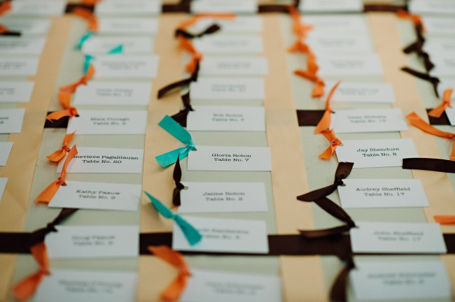 orange, teal and brown ribbon escort cards