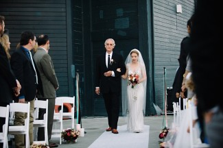 Bride walking down aisle with father for wedding at the Seattle Aquarium ceremony
