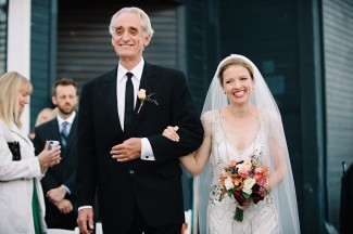 Bride walking down aisle with father at Seattle Aquarium Wedding Ceremony