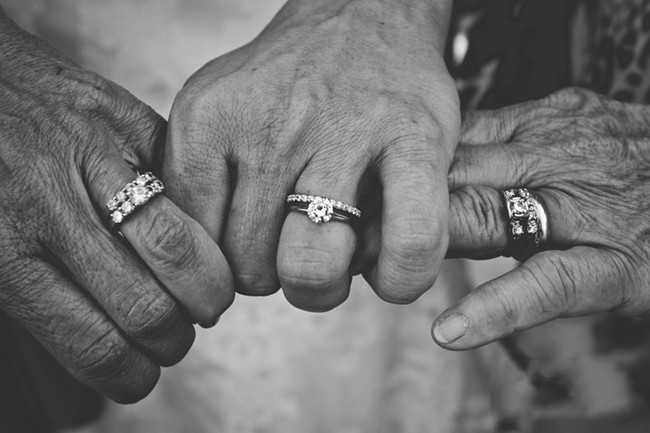 black and white photo of three generations of wedding rings
