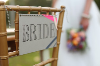 7. bride sign for wedding reception on gold chevalier chair