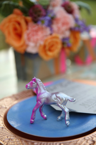 silver and purple horse on bronze charger for reception decor