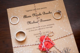 Christmas themed wedding invitation wrapped in candy cane twine