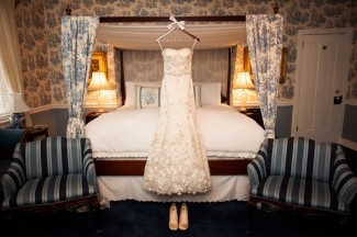 wedding gown hangs in room at Antrim 1844 Hotel