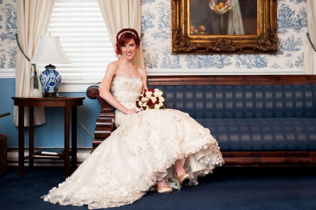 Bride sitting on vintage couch in Antrim 1844 Hotel