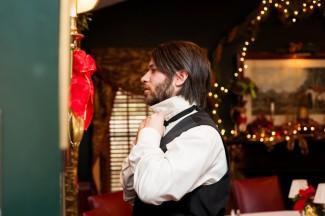 groom adjusting black necktie