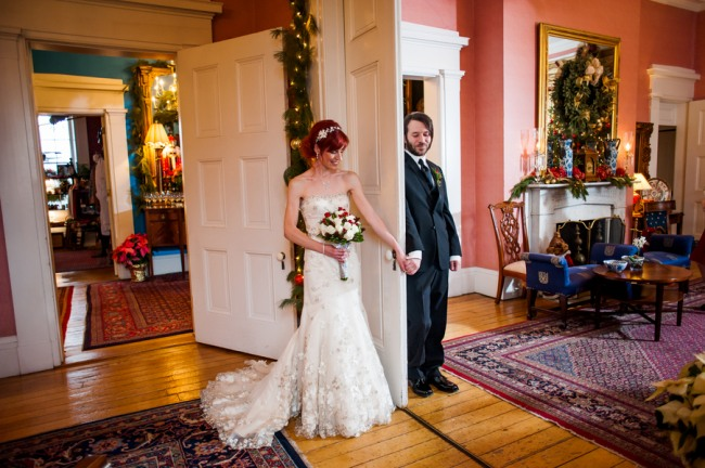 Bride and groom on opposite side of door inside Antrim 1844 Hotel for first look