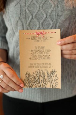 guest holding custom Christmas inspired wedding program