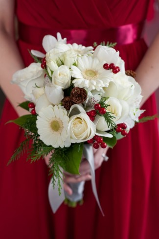bridesmaid bouquet with white roses, pine cones, and holly berries