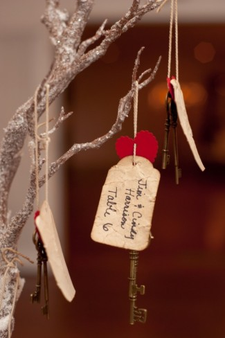 Closeup of table number tag hanging from branch