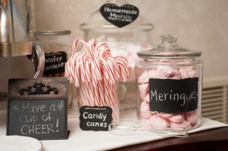 Christmas inspired wedding dessert table with candy canes, wafer cookies, and meringues