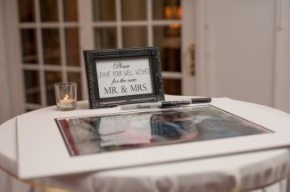 mirror guest book on table for guests to sign with sharpie pen