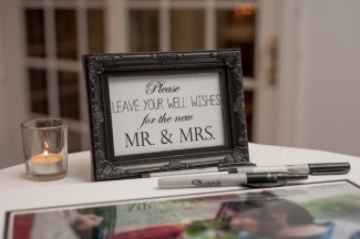 """Sign that reads, """"Please leave your well wishes for the new Mr. & Mrs."""""""