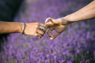holding hands with lavender in background