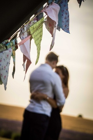 Couple hugging with bunting streamers in foreground