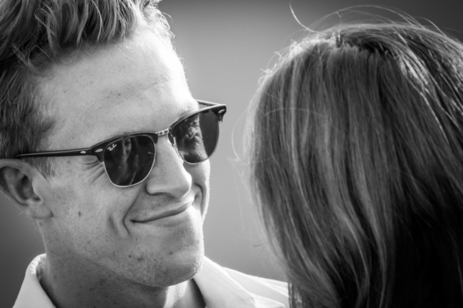 Black and white photo of groom-to-be smiling