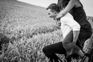 black and white photo guy giving piggy back ride in lavender field