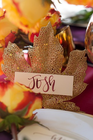 Gold maple leaf name tag holder for a dinner party
