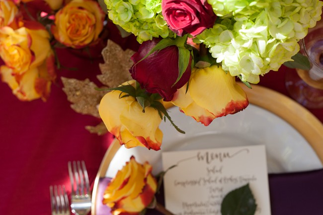white green hydrangeas with yellow and red rose floral center piece