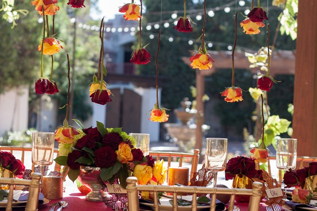 red rose styled wedding shoot at Franciscan Gardens roses hang from arbour