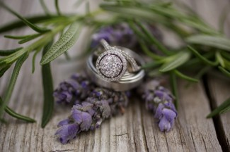Diamond halo ring and white gold men wedding band on fresh lavender