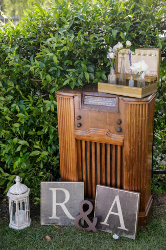 Vintage radio for wedding decor with chalkboard initials of the bride and groom