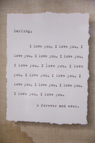 A typed not that says I love you repeated many times