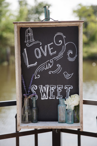 "Wedding decor chalk board sign with ""Love is Sweet"""