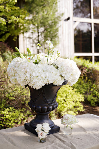 White hydrangeas in back urn for outdoor wedding decor