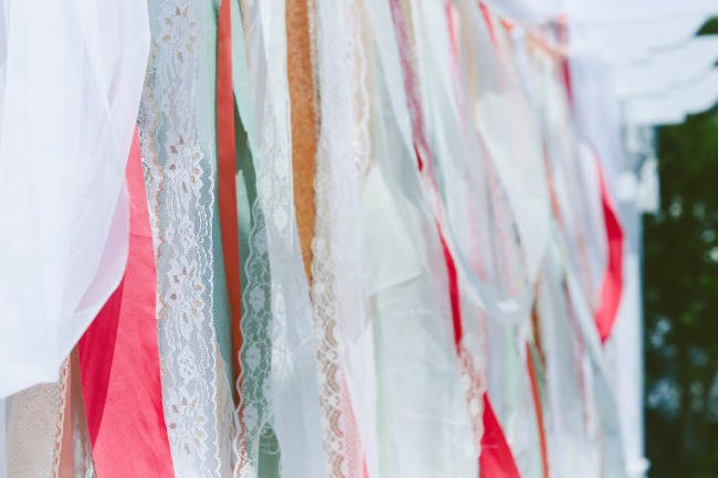 coral, teal and lace strips for wedding ceremony backdrop decor