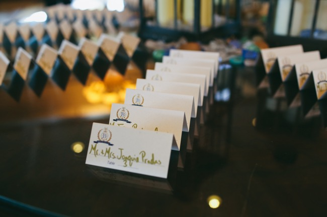 Gold and blue nautical themed escort cards for wedding reception