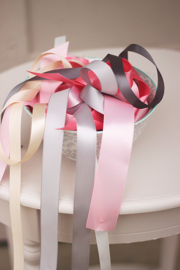 Bowl of colorful pink, grey ribbon for DIY ceremony Backdrop