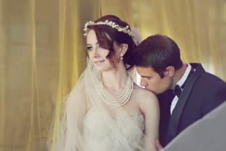 groom kisses bride on shoulder