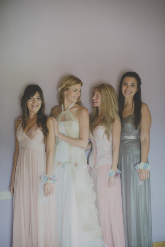 bride with bridesmaids wearing mismatched bridesmaids dresses in pink and grey