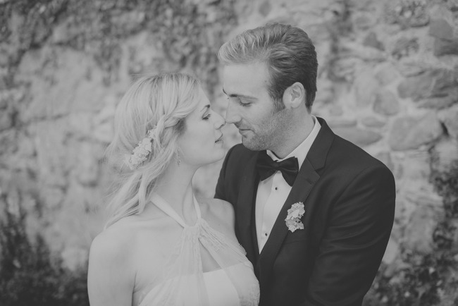 Black and white photo of bride looking at each other about to kiss