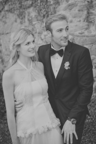 black and white photo of bride and groom looking off to the right