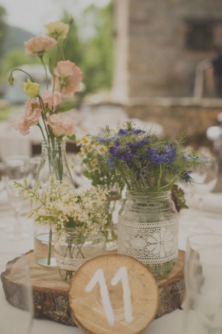 Rustic table center piece with mason jars, lace, wooden slab