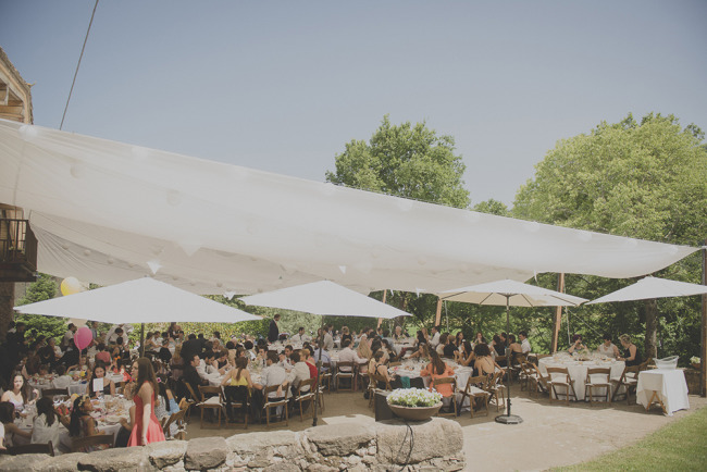 Outdoor wedding reception at private estate in Spain with large white canope