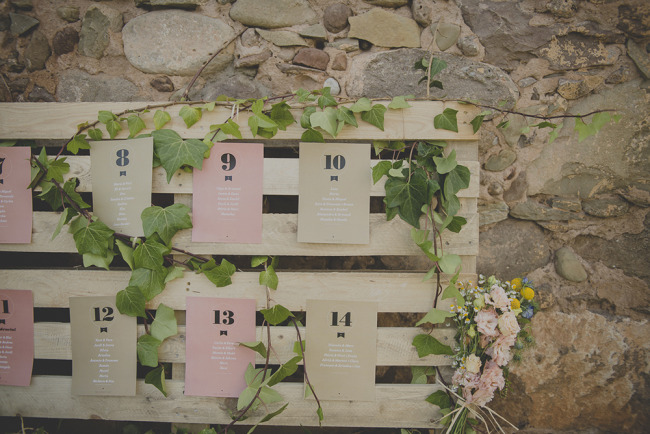 Outdoor wedding table number chart on wooden crates