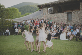 Group of junior gymnast performing a dance routine for wedding guests