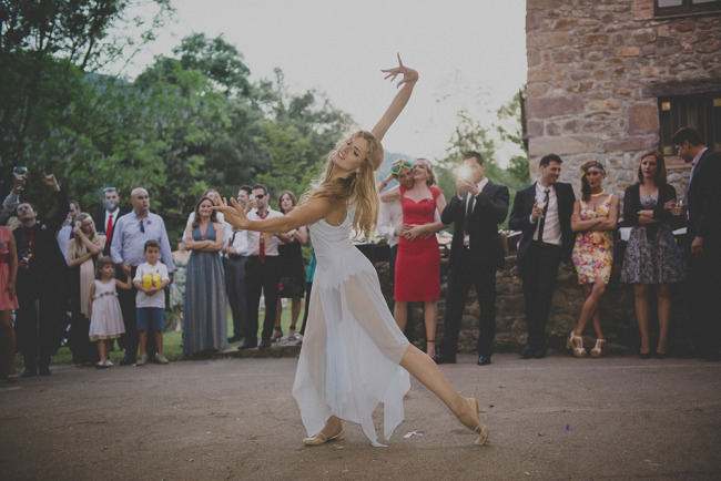 Bride performing a dance outside for wedding guests