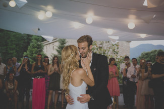 Bride and groom dancing under outdoor wedding reception tent
