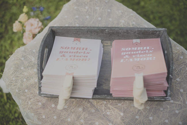 Pink and white wedding program that can also be used as fans