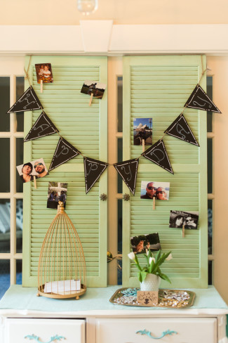 Green shutters with pictures of the bride and groom and black bunting