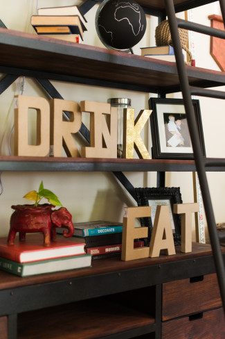 Drink and Eat spelled out on the shelf in big 3D letters