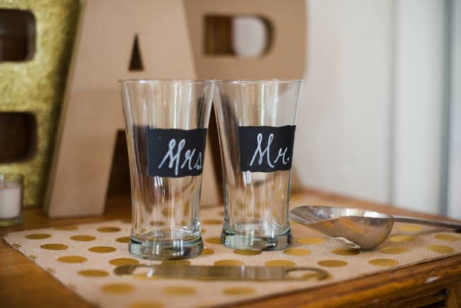 Two glass cups with chalkboard stickers and Mr and Mrs written on them